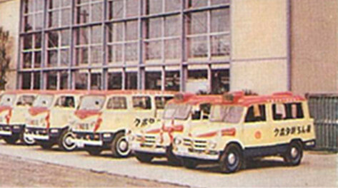 Service vehicles lined up in front of the headquarters building